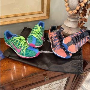 Two Pairs of Nike Rival XC Shoes